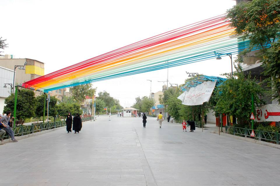Hanieh Alizadeh, Mahmoud Ganji, Mehdi Rabie (EOT design studio). Whispering Rainbow, 2012. Satin ribbon. Hefdah-E-Shahrivar Street, Tehran. Photo via EOT design studio's Facebook.